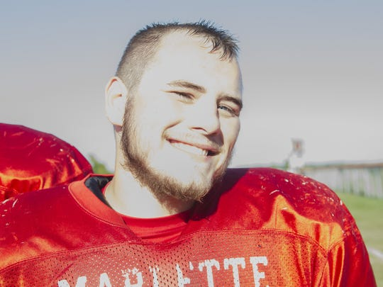 Chorben Chisholm plays running back for Marlette High School.