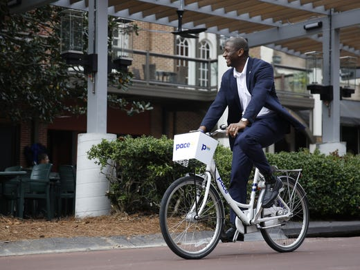 Mayor Andrew Gillum tries out a pace bike