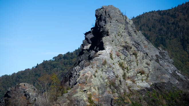 Severe burn damage is visible on a rock face at the summit of Chimney Tops trail in Great Smoky Mountains National Park on Oct. 4, 2017. The trail, which has been closed since last year's wildfires, will reopen to the public on Friday, however there will no longer be access to the rock face summit or the quarter mile of trail leading up to it. The trail now includes a new observation point for hikers.