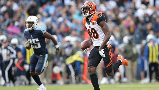 Cincinnati Bengals wide receiver A.J. Green (18) catches a slant and runs for a touchdown in the fourth quarter during the Week 10 NFL game between the Cincinnati Bengals and the Tennessee Titans, Sunday, Nov. 12, 2017, at Nissan Stadium in Nashville, Tennessee.