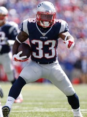 New England Patriots running back Dion Lewis (33) during the first half against the Buffalo Bills at Ralph Wilson Stadium.