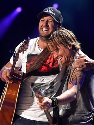 Luke Bryan and Keith Urban perform together on the last night of the 2016 CMA Music Festival at Nissan Stadium.