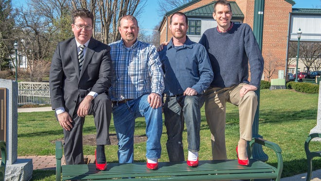 Dave Keller, Franklin County Commissioner, left, Steve Cook, Bob Boyce and Mayor Darren Brown pose together in red high heels for Walk a MIle in Her Shoes on Tuesday, March 29, 2016 in Chambersburg, Pa. The walk will take place May 6, 2016 in Downtown Chambersburg at 6:30 p.m.