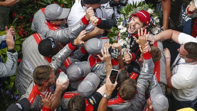 Team Penske crew members surround Will Power  after he won the  Indianapolis 500.