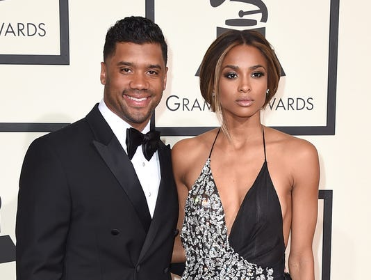 AP PEOPLE RUSSELL WILSON CIARA A FBN FILE ENT USA CA