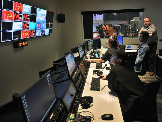 Broadcast journalism students prepare to record a news show Thursday morning in the new mass communications building at Midwestern State University. The building is an addition to the Fain College of Fine Arts and a grand opening ceremony was held.