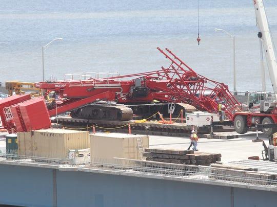 A crane working on the new Tappan Zee Bridge fell across