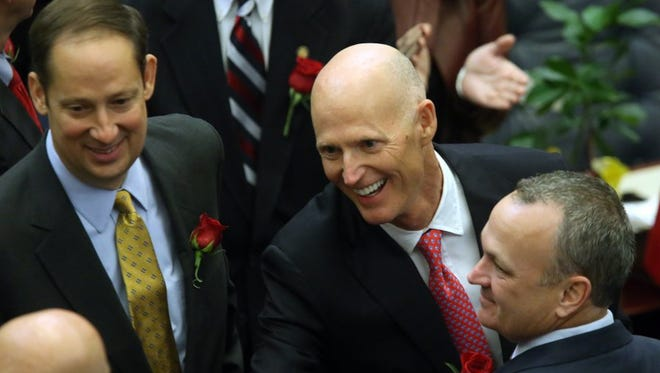 Gov. Rick Scott flanked by Sen. Joe Negron, R-Stuart, (left) and Rep. Richard Corcoran, R-Land O' Lakes, makes his way to the podium to deliver his State of the State address on the first day of session Jan. 12, 2016 in Tallahassee.