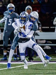 Brookfield Central sophomore Tommy Maurice (background) battles Waukesha West's Trae Tetzlaff for a pass during the Level 4 Division 2 playoff game at Oconomowoc on Friday, Nov. 10, 2017.
