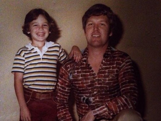 Chris Lockard, age 5, with his father Donnie. The pair