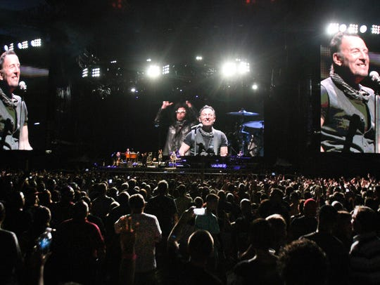 Bruce Springsteen towers over the audience as he performs