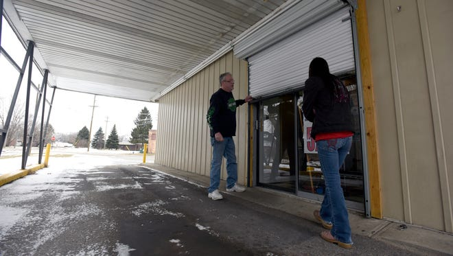 Kirk Bailey, left, opens the door for the drive through with his wife and owner of Brian's Drive-Thru Eggairy, Carlen Bailey, Sunday, Feb. 5, in Port Huron.