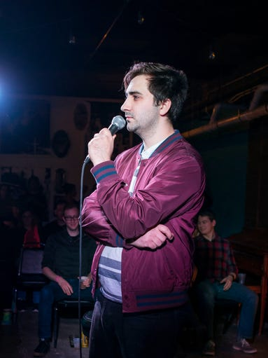 Cody Banks, 25, of Cedar Rapids, performing stand up,
