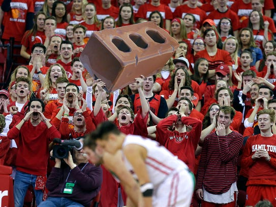 Sussex Hamilton fans make noise to try to ice a free throw by Oshkosh North in the Division 1 state semifinal March 16.