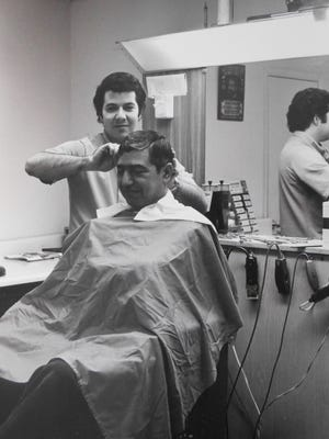This circa 1972 photo shows Al Pezzimenti cutting John Mandrino's hair at Al's Barber Shop in Victor. Pezzimenti said Mandrino, now in his 80s, still gets his hair cut at the shop.