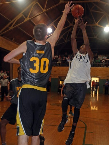 Jamil Gambari of Woodlands, playing for The City, gets off a shot over Gabe Brown of Ward Melville, playing for the New York Panthers during a semifinal CYP Tournament game at Our Lady of Mercy Church in Port Chester March 26, 2014.