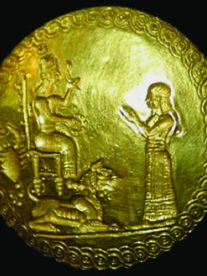 This gold seal was found with Hama's skeleton and probably hung from her neck when she was placed in her coffin. It shows a scorpion and a woman standing reverently in front of a goddess.