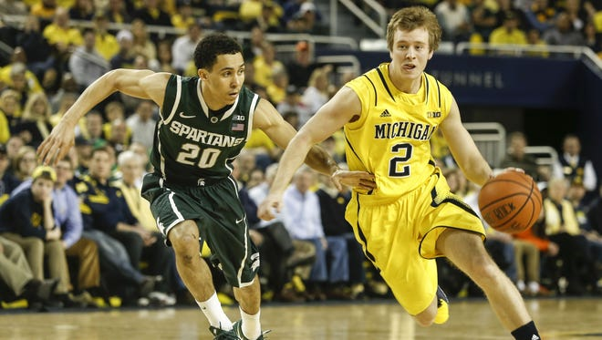 Michigan State Spartans guard Travis Trice tries to keep up with Michigan Wolverines guard Spike Albrecht on Feb. 23, 2014 at Crisler Center in Ann Arbor. Jarrad Henderson/Detroit Free Press