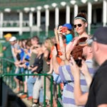 Harmony Ray, of Portland, Or., watches as Kentucky Derby winner American Pharoah works out at Churchill Downs, Saturday, May 30, 2015. (Timothy D. Easley/Special to the C-J)