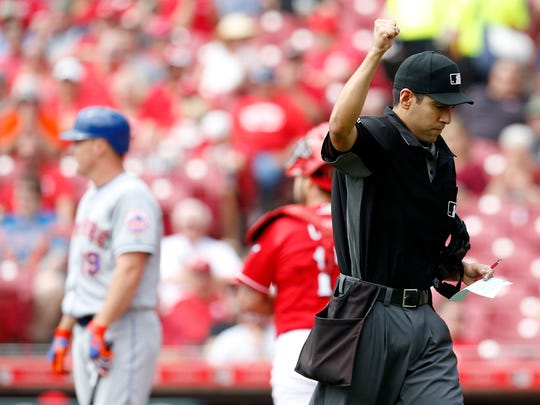Home plate umpire Gabe Morales (47) calls out New York