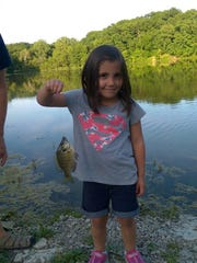 Kyrie Tolar 5, with her first fish, a bluegill from