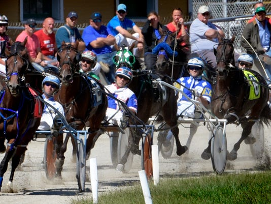 Drivers jockey for position during harness racing at the York Fairgrounds Monday, Sept. 14, 2015. Horses race for prize money in the non-betting races. Harness racing continues Tuesday at 10:30 a.m. Bill Kalina - bkalina@yorkdispatch.com