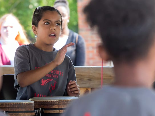 Brisa Barreto plays drums along with classmates from