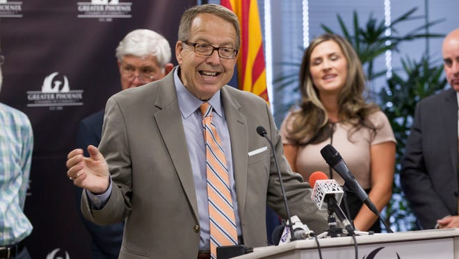 Joseph R. Sigg, in front, of Arizona Farm Bureau Federation, with other Phoenix local business and religious leaders holding a press conference at the Greater Phoenix Chamber of Commerce to announce a letter calling on Congress to pass immigration reform on Tuesday, May 13, 2014.