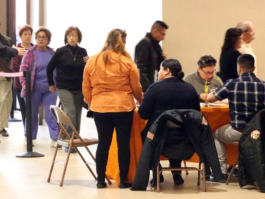 Hundreds of El Paso homeowners waited in line in the