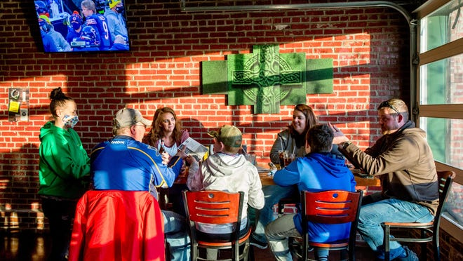 Members of the Teaney family and the Brown family, all of Pekin, place their dinner orders with general manager Mallory Morris on Sunday at West Dublin Pub in Pekin.