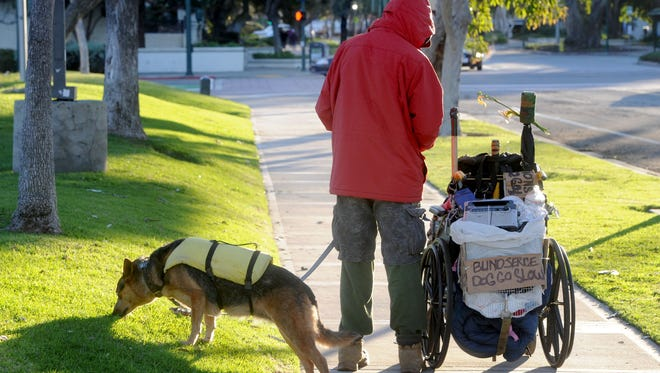 Michael Moore walks near Ventura Avenue in Ventura with his dog Dottie. Moore was among the people surveyed for the 2017 Ventura County Homeless Count.