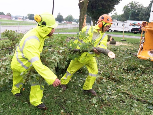 York Tree Service employees Tighe Smith, left, and