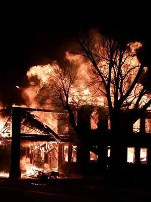 Fire engulfs the former Caylor-Nickel Hospital in Pennville early Wednesday morning, Feb. 3, 2016.