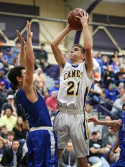 Campbell County's Tanner Clos puts up a shot in the lane.