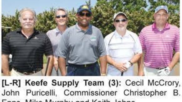 This photo from an MDOC newsletter shows Epps and McCrory posing at the 2014 Commissioner's Golf Classic. They played on the Keefe Supply Team. Keefe is one of the companies cited in the indictment.