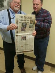 Gary Sternhagen, from Fives Giddings and Lewis, coordinator of the 2005 collection for victims of Hurricane Katrina, and Ron Jacobson, director of social services at Salvation Army of Fond du Lac, look over a copy of The Reporter from Sept. 8, 2005. The two men are back together again to team up to aid recent Hurricane victims.