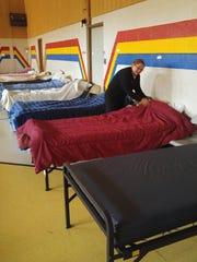 Captain Telinda Wilson adjusts the bedding on one of