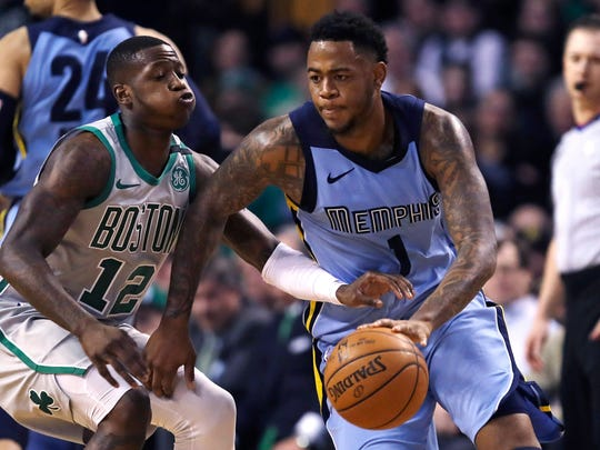 Memphis Grizzlies forward Jarell Martin (1) tries to drive past Boston Celtics guard Terry Rozier (12) during the first quarter of an NBA basketball game in Boston, Monday, Feb. 26, 2018. (AP Photo/Charles Krupa)