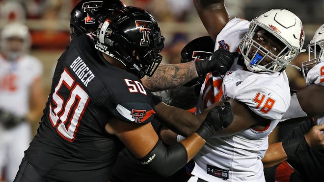 Texas Tech offensive tackle Josh Burger (50) blocks Houston Baptist linebacker Philip Ossai (48) during the Red Raiders' season-opening 35-33 victory on Sept. 12. Burger announced Friday he plans to return for the 2021 season, becoming the ninth Tech senior to take advantage of the NCAA's not charging any player a year's eligibility for 2020.
