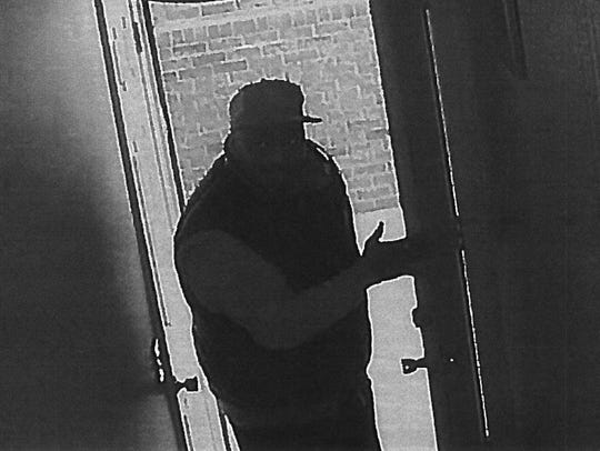 Surveillance image of a suspect wanted in connection
