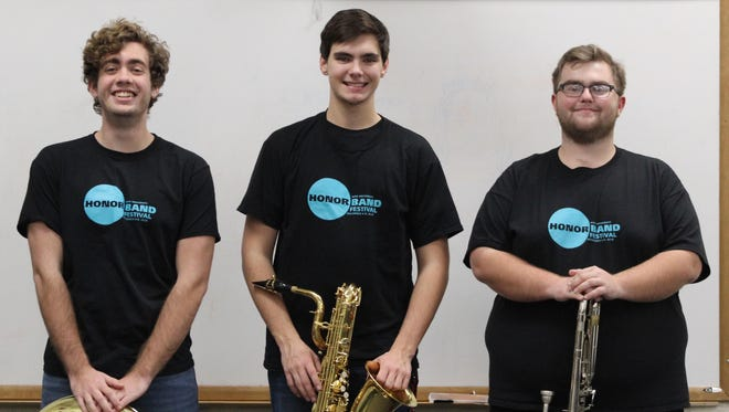 Three Clermont Northeastern High School seniors performed with the Ohio University Honor Band in December. From left: Sam Wood, Gabe Beebe and Noah Curran.