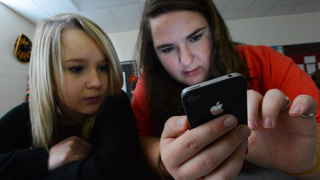 Students at Hartselle High School in Hartselle, Ala.,  use personal technology devices such as cellphones and tablets for social media and academics.
