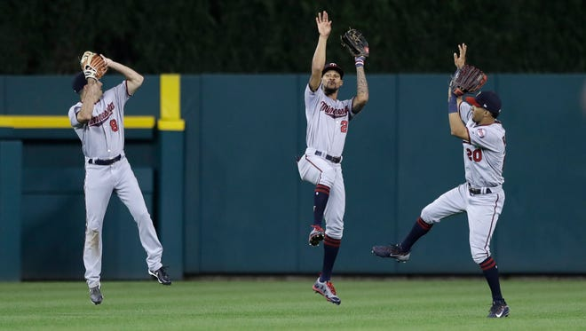 Minnesota Twins left fielder Zack Granite (8), center fielder Byron Buxton (25) and right fielder Eddie Rosario (20) celebrate the Twins' 10-4 win over the Detroit Tigers in a baseball game, Saturday, Sept. 23, 2017, in Detroit.