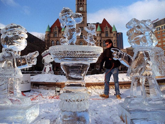 Ice sculptor Terry Reis sets up lights around a display