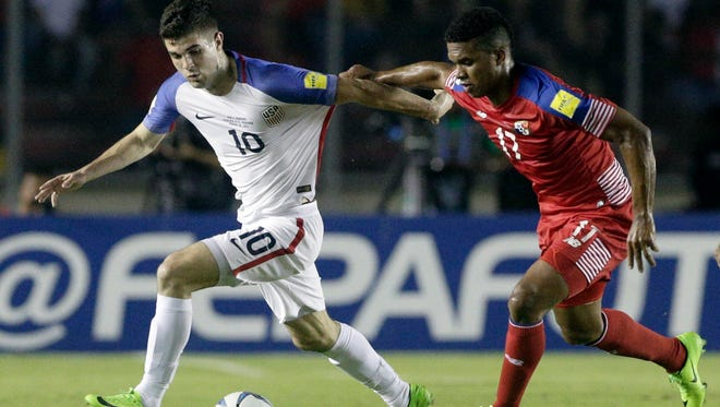 Christian Pulisic, left, assisted on a goal Tuesday night despite facing physical play.