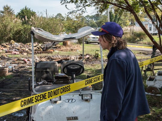 Brandon Staab, 16, of Marion Station, observes damage
