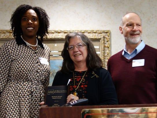 Margaret Fairman, center, received the surprise award