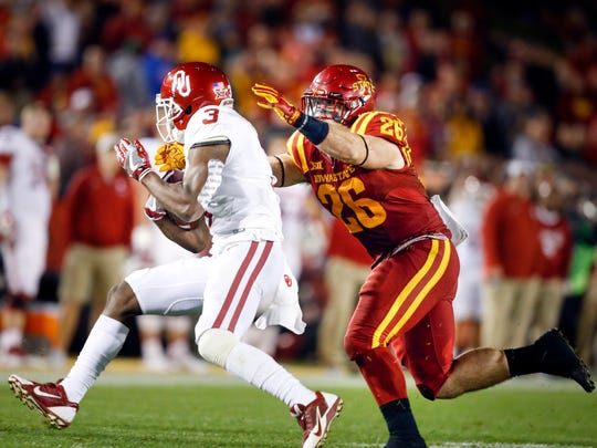 Iowa State's Mackenro Alexander (26) tackles Connor McGinnis (3) during a game against Oklahoma at Jack Trice Stadium Thursday, Nov. 3, 2016,