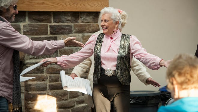 Craig Huber of Haddon Heights (left) and Irene Cervino of Haddon Heights rehearse a scene from the murder mystery 'Murder in the Heights' in the Haddon Heights Cabin.  The show is Dec. 15.