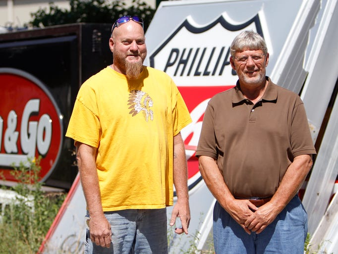 Greg Barber and Payne Sign Company owner Ron Barber on Tuesday, August 12, 2014.